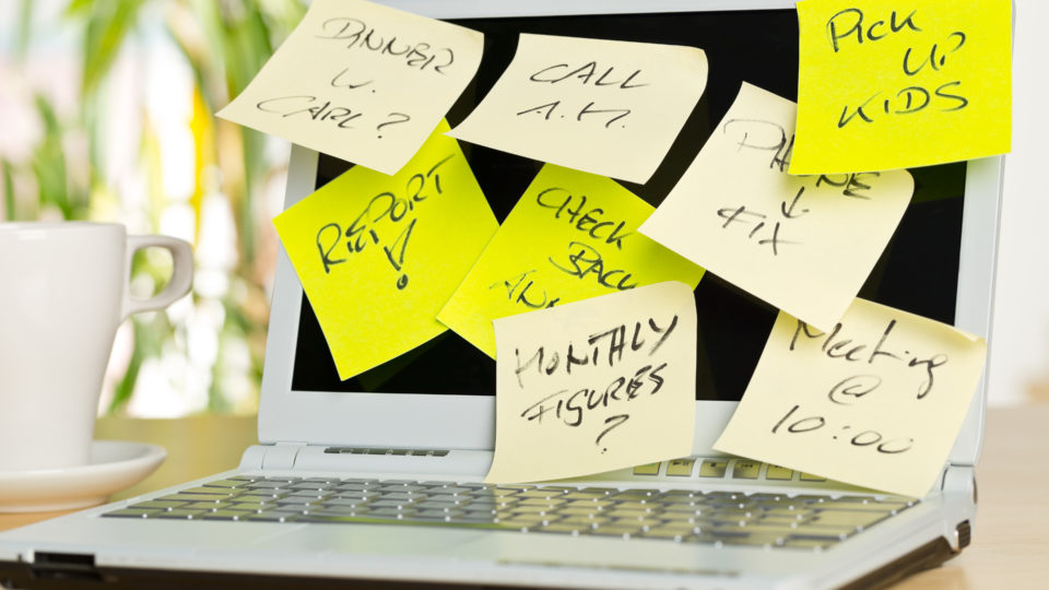 Laptop Screen Covered With Sticky Notes With Different Appointme